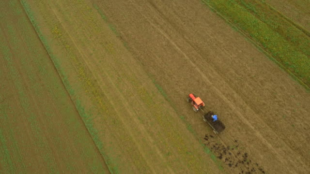 AERIAL Farmer Cultivating A Field In The Morning