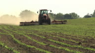 WS SLO MO Farmer cultivating field of organic soybeans / Columbus, Wisconsin, USA