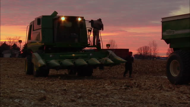 WS farmer getting out of harvester at dusk/ Manchester, Michigan