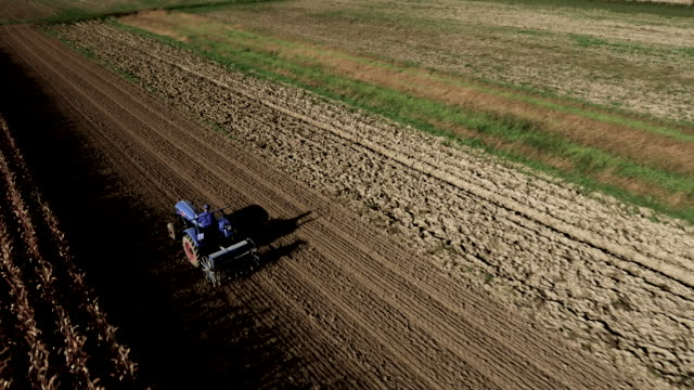 AERIAL Farmer Harrowing A Field
