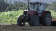 WS PAN ZI Farmer in tractor plowing field, New South Wales, Australia