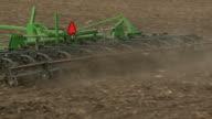 PAN MS CU Farmer plowing field, Newark, Illinois, USA