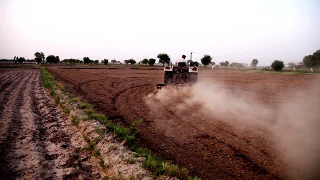 Farmer plowing field