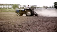 Farmer plowing field