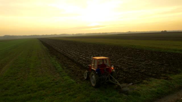 AERIAL Farmer Plowing The Field