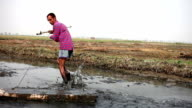 Farmer pulling agriculture equipment