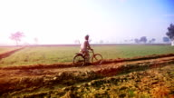 Farmer riding cycle to the filed