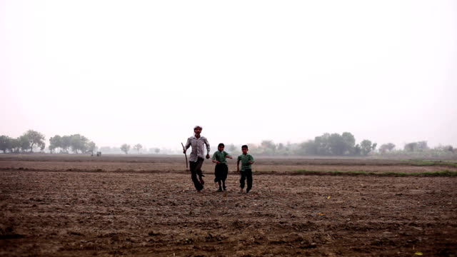 Farmer running in the empty field