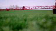 farmer spraying a wheat field with tractor.