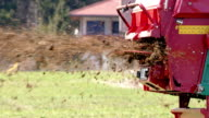 SLO MO Farmer spreading manure with a tractor