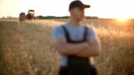 Farmer supervises harvest