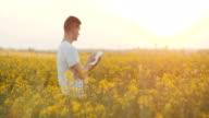 Farmer using Digital Tablet Computer 4K