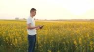 Farmer using Digital Tablet Computer on field