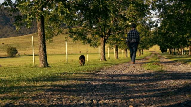 Farmer With Dog
