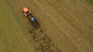 AERIAL Farmer Working On Field In The Morning