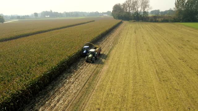 AERIAL Farmers Cutting Corn Silage