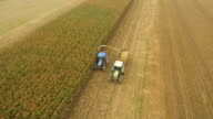 AERIAL Farmers Cutting Corn Silage
