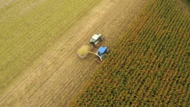 AERIAL Farmers Cutting Corn
