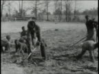 1939 MS farmers digging in field / Lowndes County, Alabama, United States