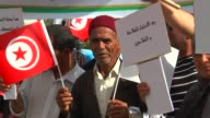 Farmers gather in front of building of the Agriculture and Waterworks Union in Tunis to stage a protest against agricultural policy of government of...