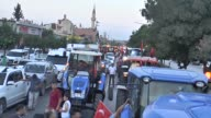 Farmers participate a convoy with their tractors during a demonstration staged to protest against Parallel State/Gulenist Terrorist Organization's...