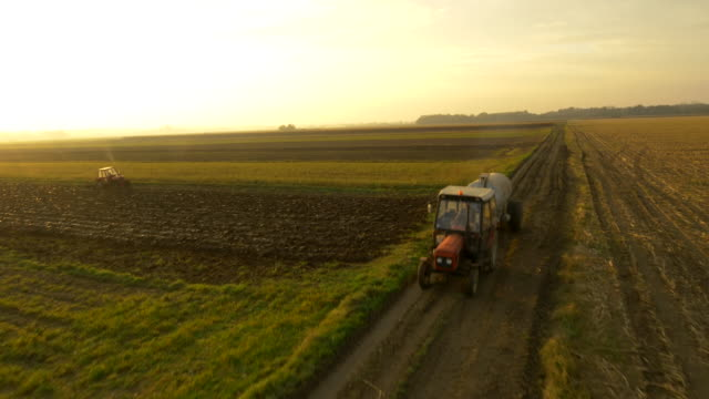 AERIAL Farmers Working With Tractors