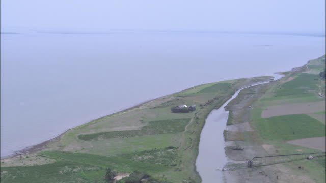 Farmland extends to the shore of the Bay of Bengal. Available in HD.