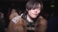 Fashion Blogger Yu Masui wears Fur coat Astros Andersen Necklace Lanvin Stripe top Luella Trousers Dries van notten Shoes Charlotte Olympia at London...