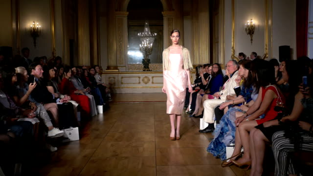 Fashion designer Grace Chen presents her new Simply Divine collection Fashion catwalk show took place at Lancaster House London on June 11 2016