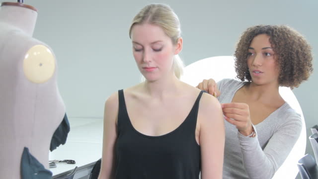 Fashion Designer measuring model in studio