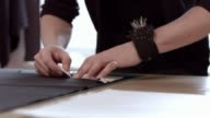 Fashion Designer working on dress pattern