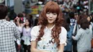 MS A fashionable girl poses for cameras in Takeshita Dori, Harajuku District / Tokyo, Japan