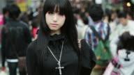 MS, TU A fashionable girl poses in Takeshita Dori, Harajuku District / Tokyo, Japan