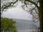 Faslane base GV Base seen thru trees ZOOM IN submarine docked