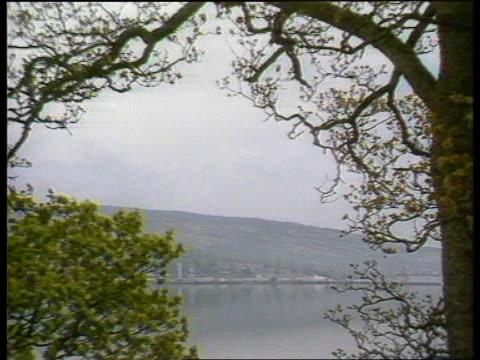 Faslane base GV Base seen thru trees ZOOM IN submarine docked