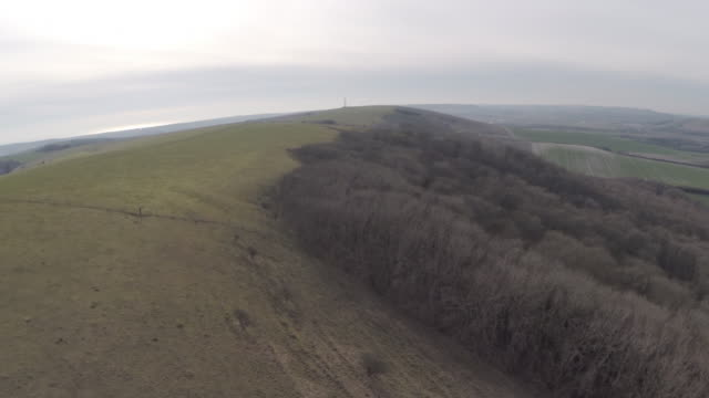 Fast aerial track over chalk downland in Sussex, UK