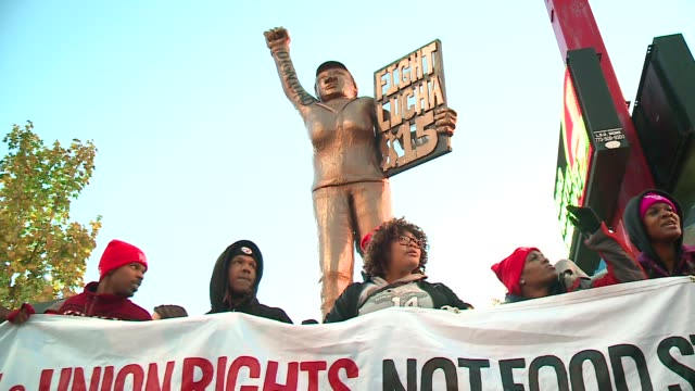 WGN Fastfood workers in Chicago hold 'Fight for $15' signs outside of a Chicago McDonald's The goal was to boost the minimum wage to $15 an hour and...