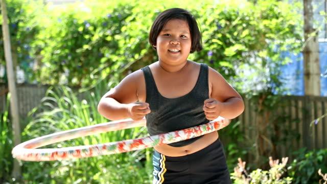 Fat girl with hula hoop