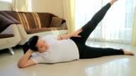 Fat woman exercising