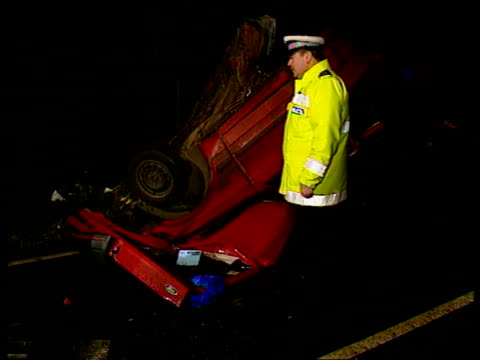 Fatal car crash in Leicestershire Nr Market Bosworth Policeman on duty beside wreckage of Ford Escort More wreckage of Ford Escort on verge MS...