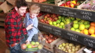 Father and child  in organic shop