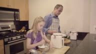 Father and Daughter Baking Together in the Kitchen