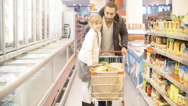 Father and Daughter In Shopping