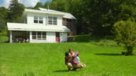 WS Father and daughter (4-5) playing in front of house, Bovina Center, New York, USA