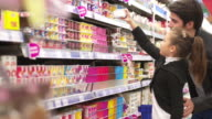DOLLY: Father and daughter shopping in a supermarket