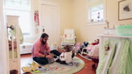 WS Father and daughter sitting on floor in daughters room playing/Seattle, Washington, USA