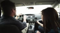 MS Father and daughter (8-9) using GPS in car / Orem, Utah, USA