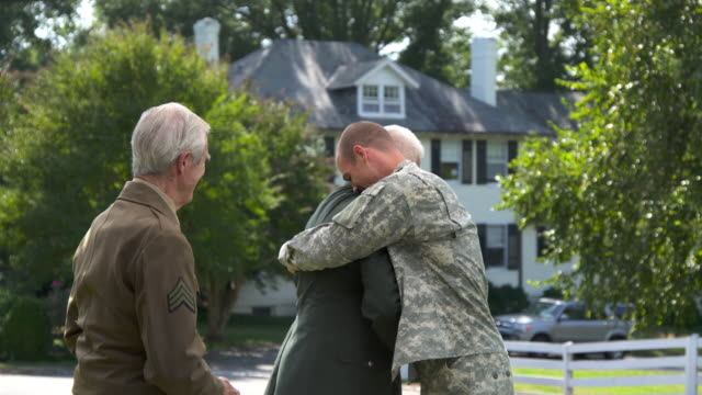 MS ZI Father and Granfather in Uniform Greeting Soldier Son Returning Home from Military Service / Richmond, Virginia, United States