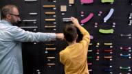 Father and son arranging product in the store