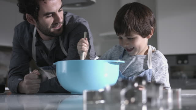 Father and son baking biscuits